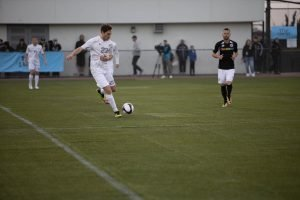 Soccer player mid-kick
